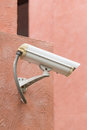 Outdoor security camera on orange wall Royalty Free Stock Photos