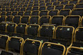 Outdoor stadium seats with yellow frames, straight on view Royalty Free Stock Photo