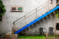 Outdoor stairway and blue clour withl wall texture on vintage st Royalty Free Stock Photo