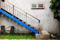 Outdoor stairway and blue colour with wall texture on vintage st Royalty Free Stock Photo
