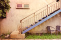 Outdoor stairway and blue colour with wall texture on vintage style picture Royalty Free Stock Photo