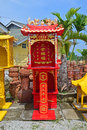 Outdoor standalone red praying altar for taoism the top and sides are engraved or carved with golden and silver dragons the Royalty Free Stock Photo