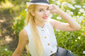 Outdoor summer portrait of young pretty cute blonde girl beautiful woman posing in the park Stock Photo
