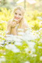 Outdoor summer portrait of young pretty cute blonde girl beautiful woman posing in the park Royalty Free Stock Photo