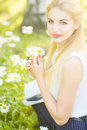Outdoor summer portrait of young pretty cute blonde girl beautiful woman posing in the park Stock Photography