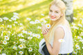 Outdoor summer portrait of young pretty cute blonde girl beautiful woman posing in the park Stock Images