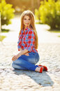 Outdoor summer portrait of young pretty cute blonde girl. Beautiful woman posing in spring. Royalty Free Stock Photo