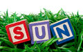 Outdoor sunday alphabet blocks forming the letters sun on a patch of grass Royalty Free Stock Image