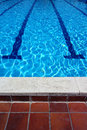 Outdoor swimming pool lanes and tiles on a sunny summer day Royalty Free Stock Photos