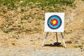 Outdoor target with bolts from a crossbow yellow fired on rural shooting range Stock Photo