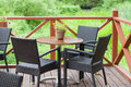 Outdoor terrace cafe table with three chairs Royalty Free Stock Photo