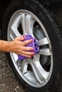 Outdoor tire car wash with sponge an Stock Photography