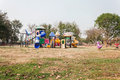 Outdoor village public playground with colourful plaything  for Royalty Free Stock Photo