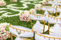 Outdoor wedding scene chairs and flowers at an Royalty Free Stock Images