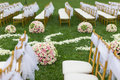 Outdoor wedding scene chairs and flowers at an Stock Photos