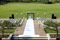 Outdoor wedding scene chairs and flowers at an Stock Images