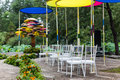 Outdoor wedding scene chairs and flowers at an party Stock Photo