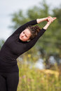 Outdoor yoga young beautiful woman practicing the art of on an outdoors setting Royalty Free Stock Photography