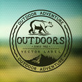 Outdoors adventure badge with blurred background vector illustration Royalty Free Stock Photos