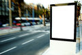 Outdoors advertising mock up, public information board on city road Royalty Free Stock Photo