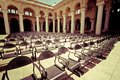 Outdoors concert hall with ancient columns rows of chairs at under cloudy sky thirumalai nayak palace india madurai vintage style Royalty Free Stock Photography