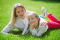 Outdoors on the grass in a park adorable mother with her daughter garden Royalty Free Stock Photography