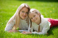 Outdoors on the grass in a park adorable mother with her daughter garden Royalty Free Stock Photo