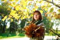Outdoors portrait of autumn girl with leaves Royalty Free Stock Photos
