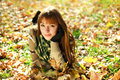 Outdoors portrait of autumn girl in yellow leaves Stock Photo