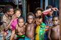 Outdoors Portrait of unidentified Papuan little kids. Royalty Free Stock Photo
