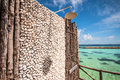 Outdoors shower with stoned wall with view to blue lagoon in tropical resort Royalty Free Stock Images