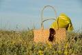 Outdoors spring still life handbag sitting flower bed Royalty Free Stock Images
