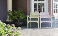 Outdoors two chairs in front of modern home Royalty Free Stock Images