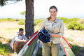 Outdoorsy couple setting up camp in the countryside Royalty Free Stock Photo