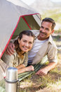 Outdoorsy couple smiling at camera from inside their tent Royalty Free Stock Photo