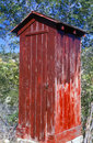 Outhouse painted red Royalty Free Stock Photo