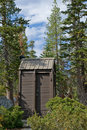 Outhouse in wilderness Royalty Free Stock Photo