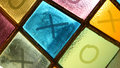 Ouths and crosses tick tack toe noughts and crosses painted on colorful stained glass window Stock Photography