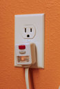Outlet electrical with gfi plug Stock Photos