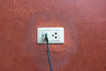Outlet on wall and plug Stock Photos