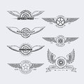 Outline logos set templates for labels and emblems in style with wheel and wings vector illustration Royalty Free Stock Photo