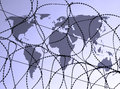 Outline map world overlaid razor wire Royalty Free Stock Photo