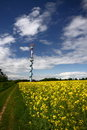 Outlook tower by the rape field slim of Stock Photos