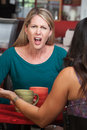 Outraged Lady in Cafe Stock Image