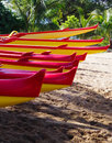 Outrigger canoes on the beach in maui hawaii bearing their individual boat names are parked kihei Royalty Free Stock Photography