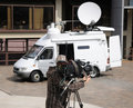 Outside broadcast tv camera an cameraman and satelite transmission vehicle england april Stock Photos