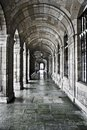 Outside the cathedral corridor with arches and stone columns Royalty Free Stock Photography
