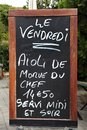 Outside menu sign for aioli diner at french restaurant Royalty Free Stock Images