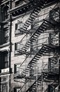 Outside metal fire escape stairs, New York City black and white Royalty Free Stock Photo