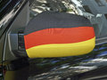 Outside mirror in black red and gold the german national flag at the car of a soccer fan berlin germany Royalty Free Stock Photos